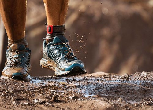 bigstock-Mud-Race-Runners-Detail-Of-The-252246925